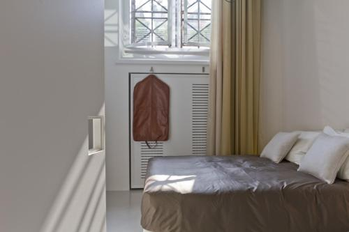 A bed or beds in a room at Suitime