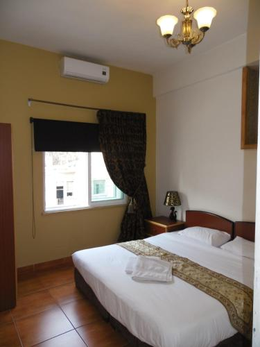 A bed or beds in a room at The Boutique Hotel Amman