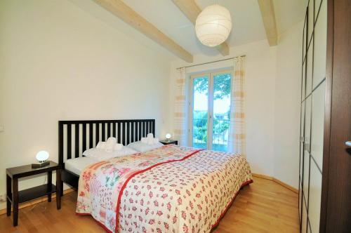 A bed or beds in a room at Apartment Aqua Tatry