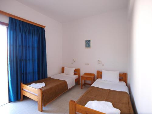 A bed or beds in a room at Irini Apartments