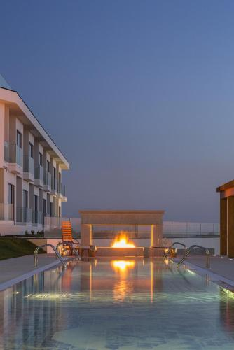 The swimming pool at or close to Royal Obidos Evolutee Hotel