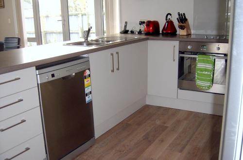 Majoituspaikan A Gem of Comfort 2 keittiö tai keittotila