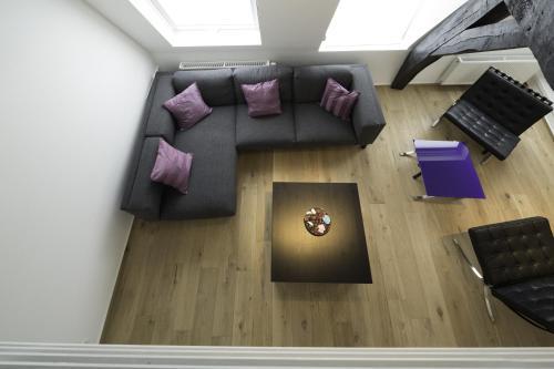 Uma área de estar em Apartments Chapeliers / Grand-Place