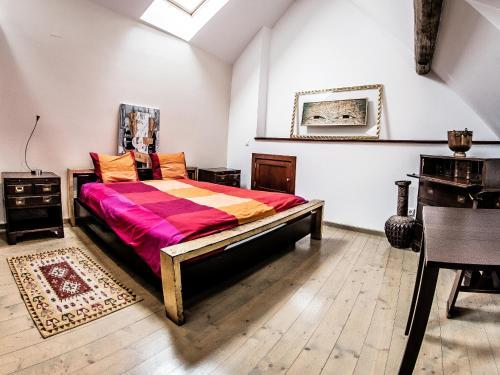 Cama ou camas em um quarto em Max Apartments