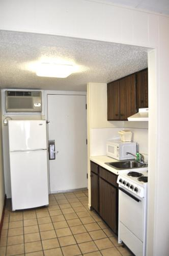A kitchen or kitchenette at Castaway Beach Inn & Swim Up Bar