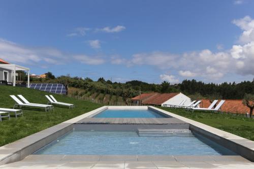 The swimming pool at or near Casa do Melgaco, Turismo Rural