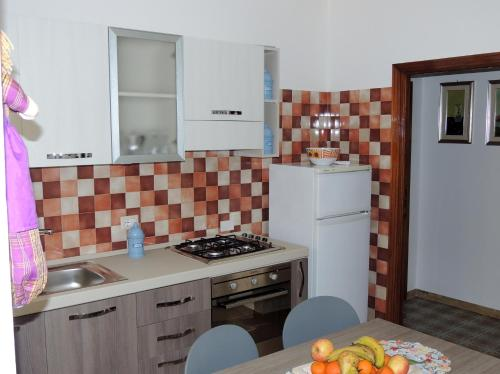 A kitchen or kitchenette at Mary Centro Storico