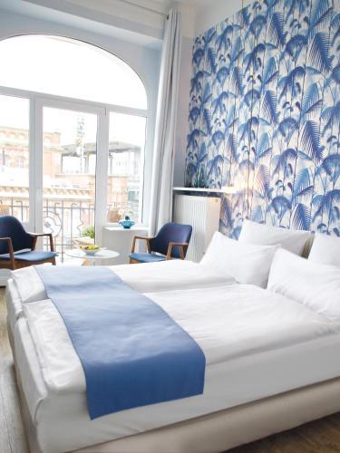 Una cama o camas en una habitación de Fritz im Pyjama