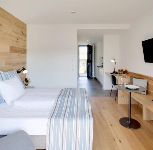Een bed of bedden in een kamer bij Hotel M120