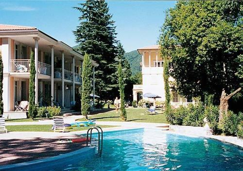 The swimming pool at or near Residence Ville Lago Lugano