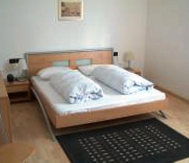 Ein Bett oder Betten in einem Zimmer der Unterkunft Pension Angergut
