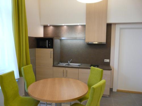 A kitchen or kitchenette at Soleil Apartman Szeged