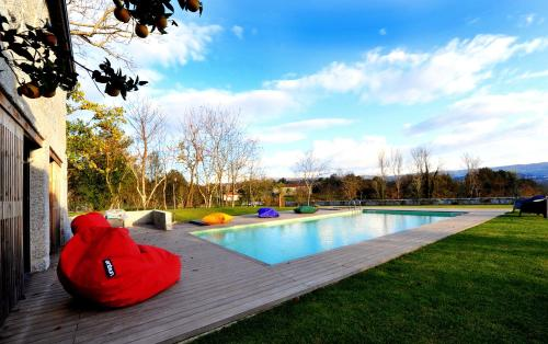 The swimming pool at or near Casas do Ermo