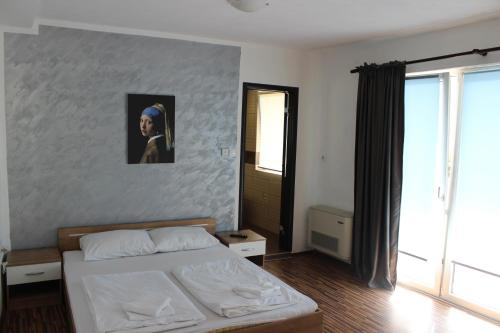 A bed or beds in a room at Apartments Bjelanović