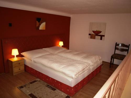 Кровать или кровати в номере Hotel Liechtenstein Apartments II