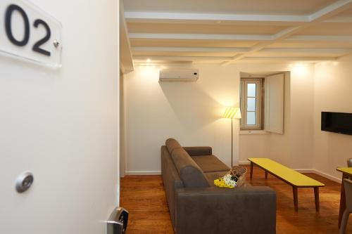 A seating area at Portugal Ways Alfama River Apartments