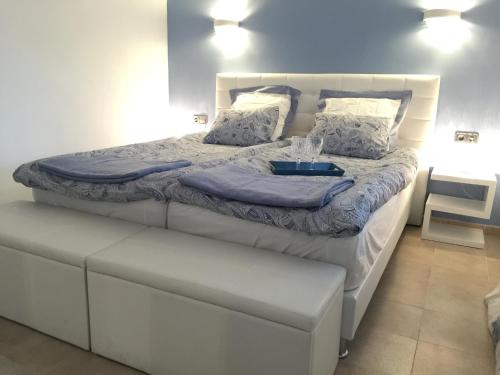 A bed or beds in a room at Canyamel Beach
