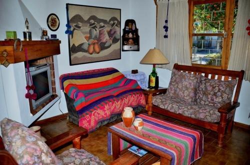 Una cama o camas en una habitación de Casa Brown