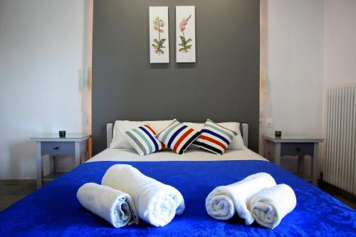 A bed or beds in a room at Seranides Boutique Hotel