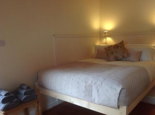 A bed or beds in a room at Bridge House Studios
