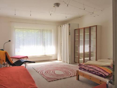 Ein Bett oder Betten in einem Zimmer der Unterkunft Ferienhaus Am Walde