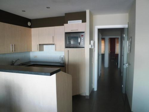 A kitchen or kitchenette at Appartement Borealis