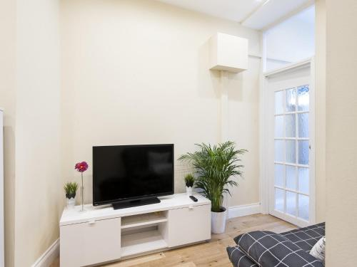 A television and/or entertainment center at London City Apartments