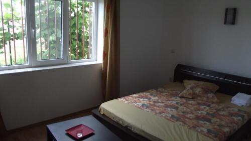 Un pat sau paturi într-o cameră la Vila Maria