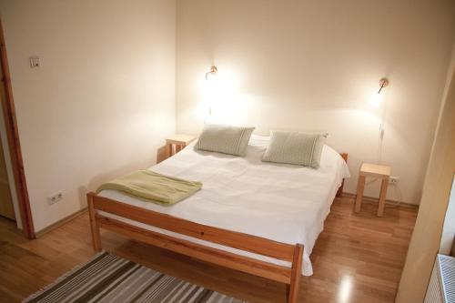 Vuode tai vuoteita majoituspaikassa Linda Apartments