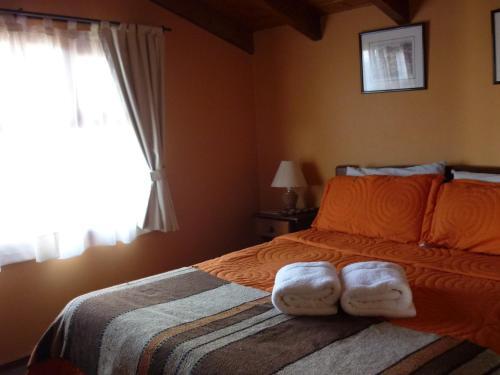 Una cama o camas en una habitación de Apart Hotel Bungalows Los Cipresales
