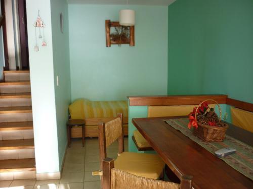 Un lugar para sentarse en Apart Hotel Bungalows Los Cipresales
