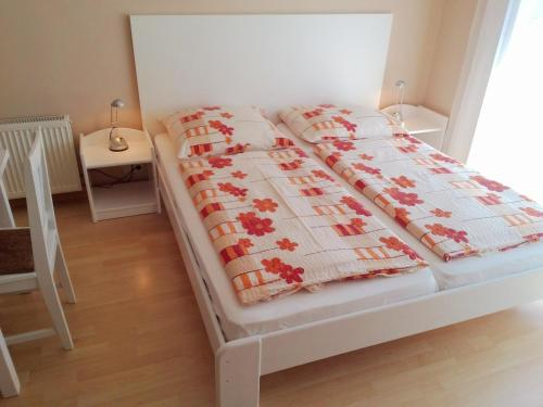 A bed or beds in a room at OREL Apartments