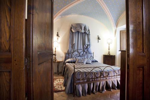 Letto o letti in una camera di Residenza D'epoca San Crispino