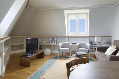 TV o dispositivi per l'intrattenimento presso Miramar Apartment by FeelFree Rentals