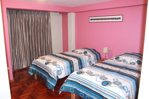 Cama o camas de una habitación en Cusco Apartment