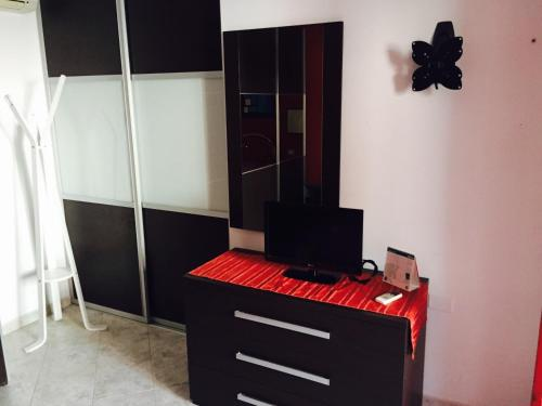 A television and/or entertainment center at Atene Apartment