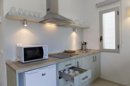 A kitchen or kitchenette at Apartaments Proa Es Pujols ( Only Adults )
