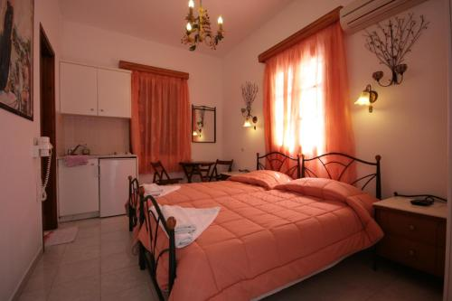A bed or beds in a room at Studios Bourgos