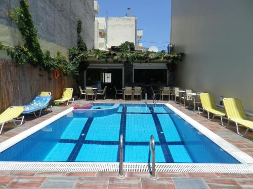 The swimming pool at or near Haris Apartments