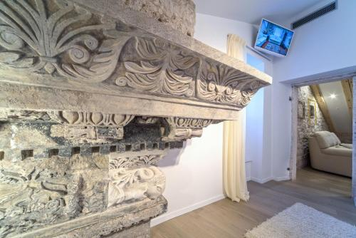 A television and/or entertainment center at Apartment Roman Heritage