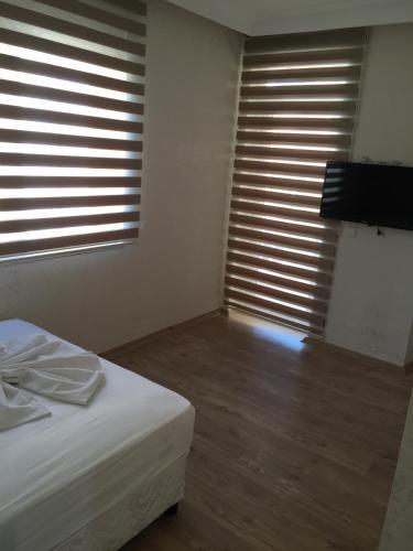 Кровать или кровати в номере Köşk Hotel