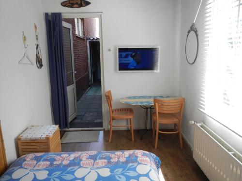 Ein Bett oder Betten in einem Zimmer der Unterkunft Endless Summer