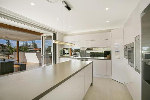 A kitchen or kitchenette at Capri Waters Holiday Home