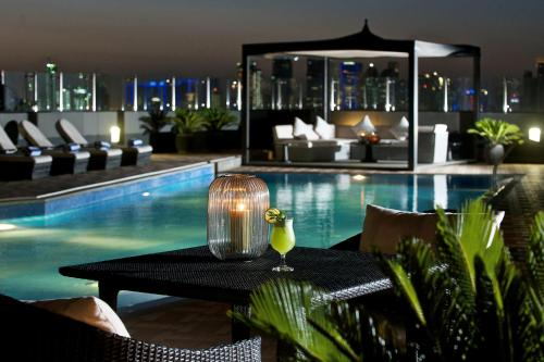 The swimming pool at or near Fraser Suites Doha