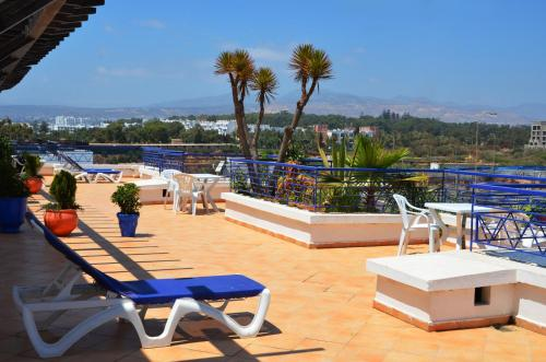 A balcony or terrace at Golden Beach Appart'hotel