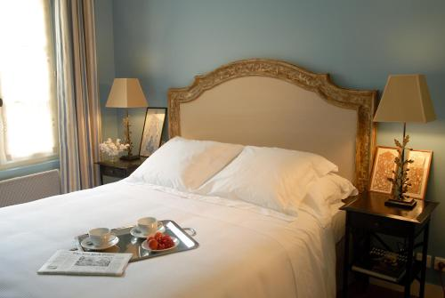 A bed or beds in a room at La Maison Saint Germain