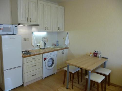 A kitchen or kitchenette at Apartments Krasnogorsk Expo Crocus