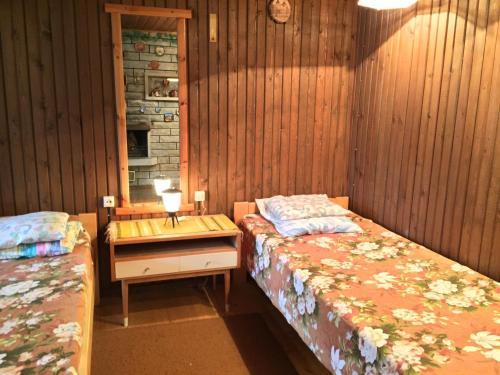 Voodi või voodid majutusasutuse Silla Puhkemaja toas