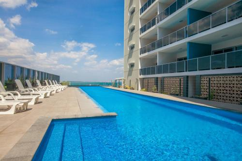 The swimming pool at or near Ramada Suites by Wyndham Zen Quarter Darwin