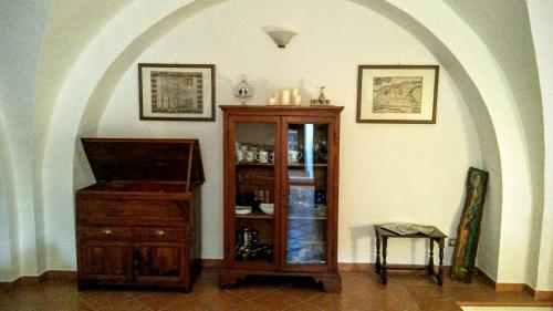 A television and/or entertainment center at Residenza Le Volte Degli Angeli